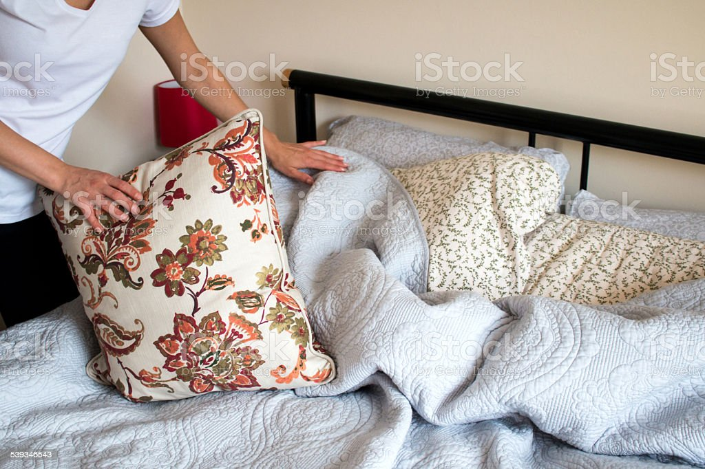 Making bed room service stock photo