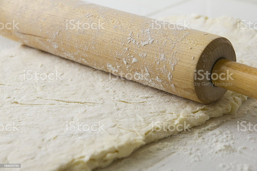 Making Biscuits - Rolling Out Dough royalty-free stock photo
