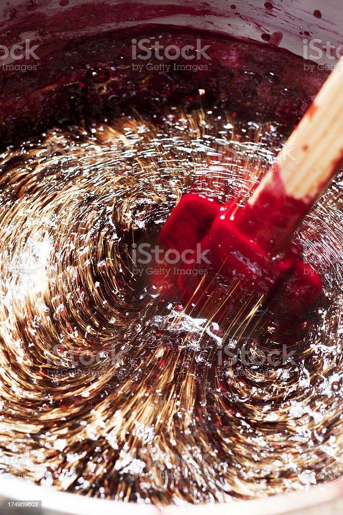 Making Blackberry Jam - Stirring royalty-free stock photo