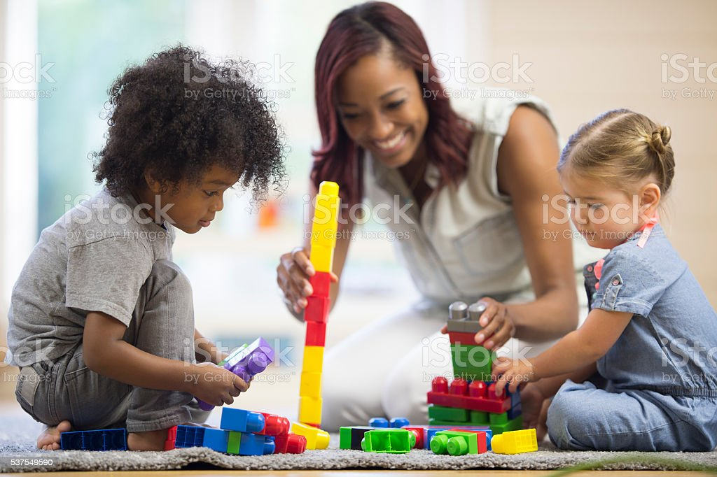 Making Block Towers Together stock photo