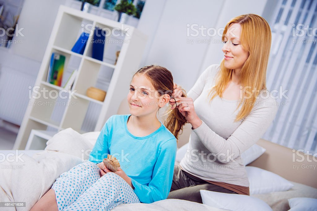Making Braids with her Daughter's Hair stock photo