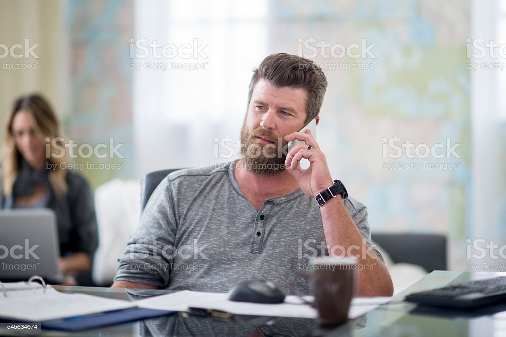 Making Calls and Working From Home stock photo