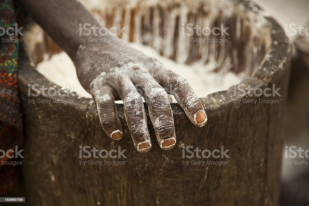 Making cassava flour by hand. stock photo