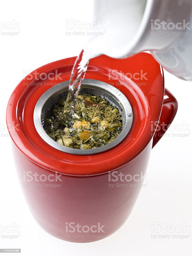 Making chamomile citrus tea infusion royalty-free stock photo