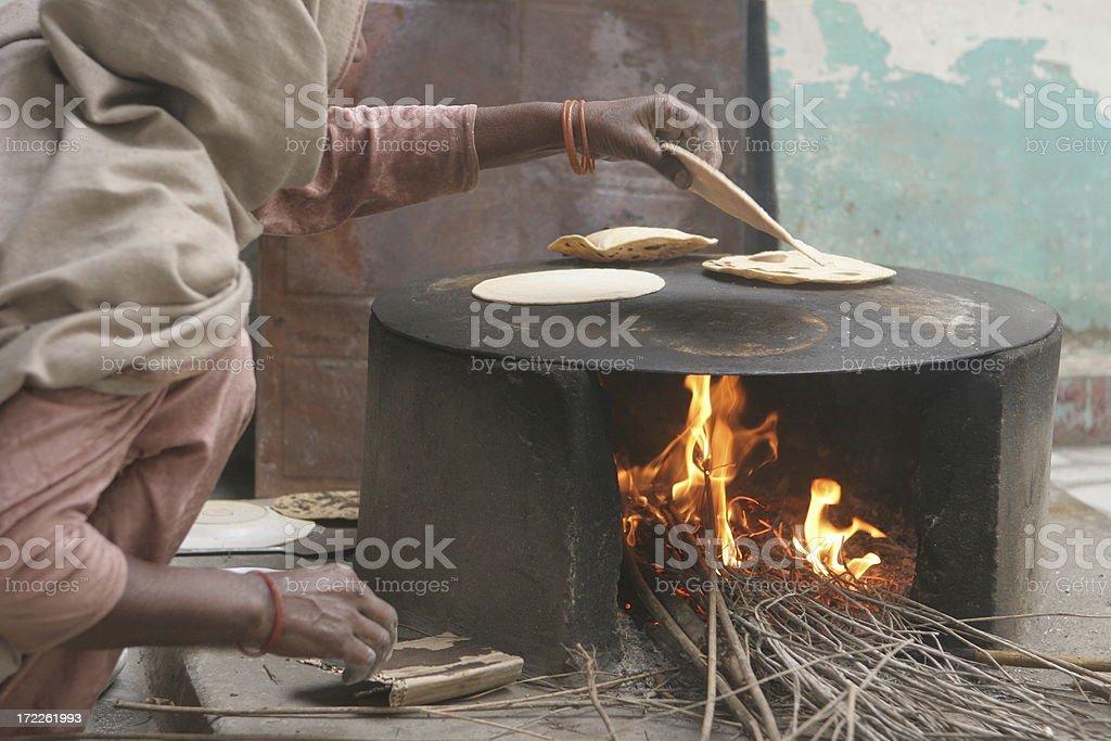 making chapatis (rotis) the traditional way stock photo