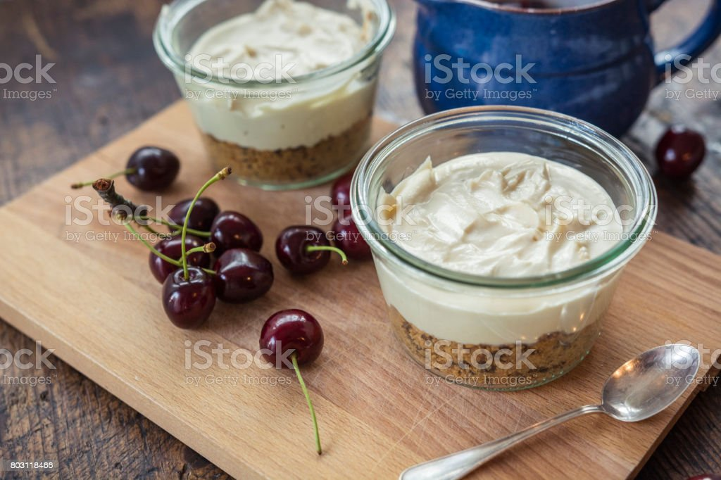 Making cheesecake with cherries in a jar. stock photo