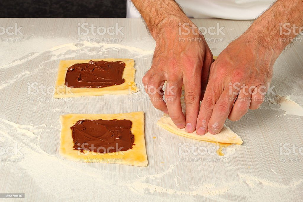 Making Chocolate Croissants with Puff Pastry royalty-free stock photo