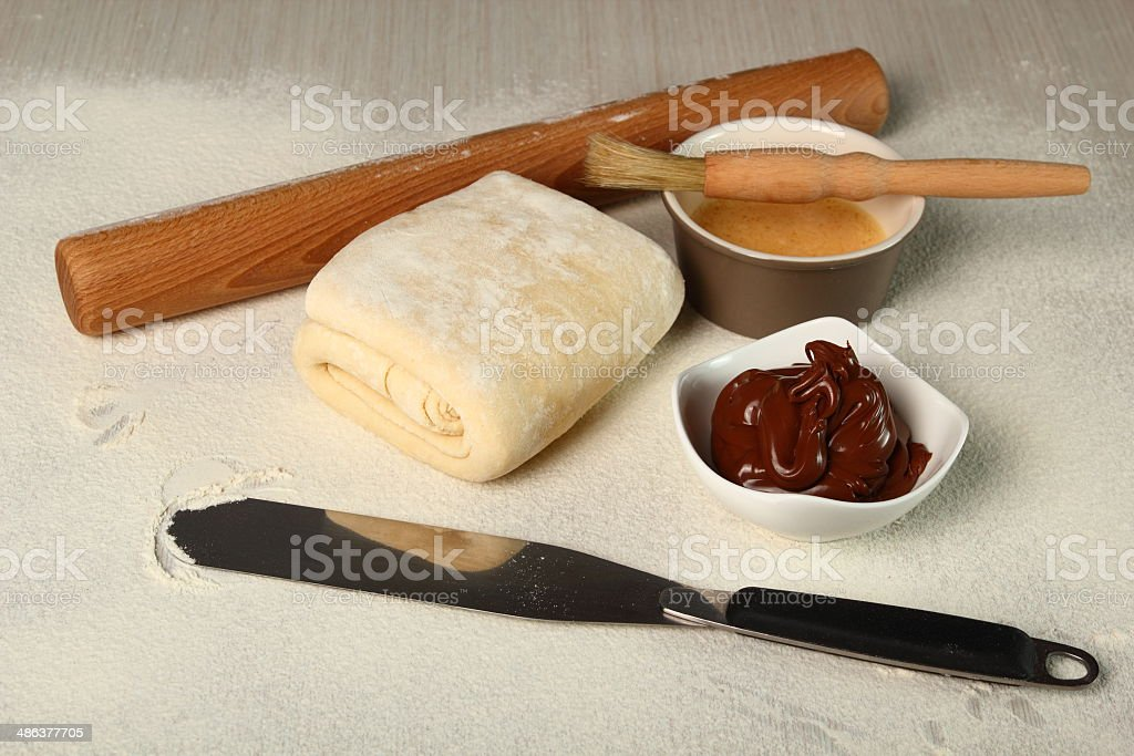 Making Chocolate Croissants with Puff Pastry stock photo
