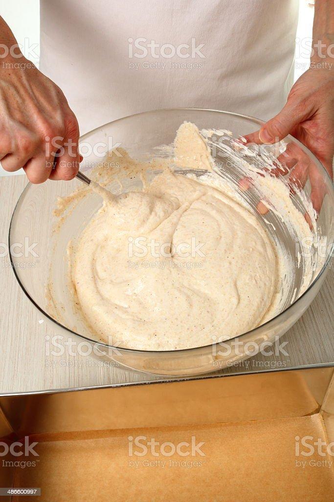 Making Chocolate Hazelnut Meringue Cake stock photo