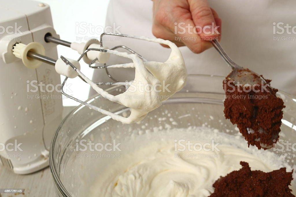 Making Chocolate Hazelnut Meringue Cake royalty-free stock photo