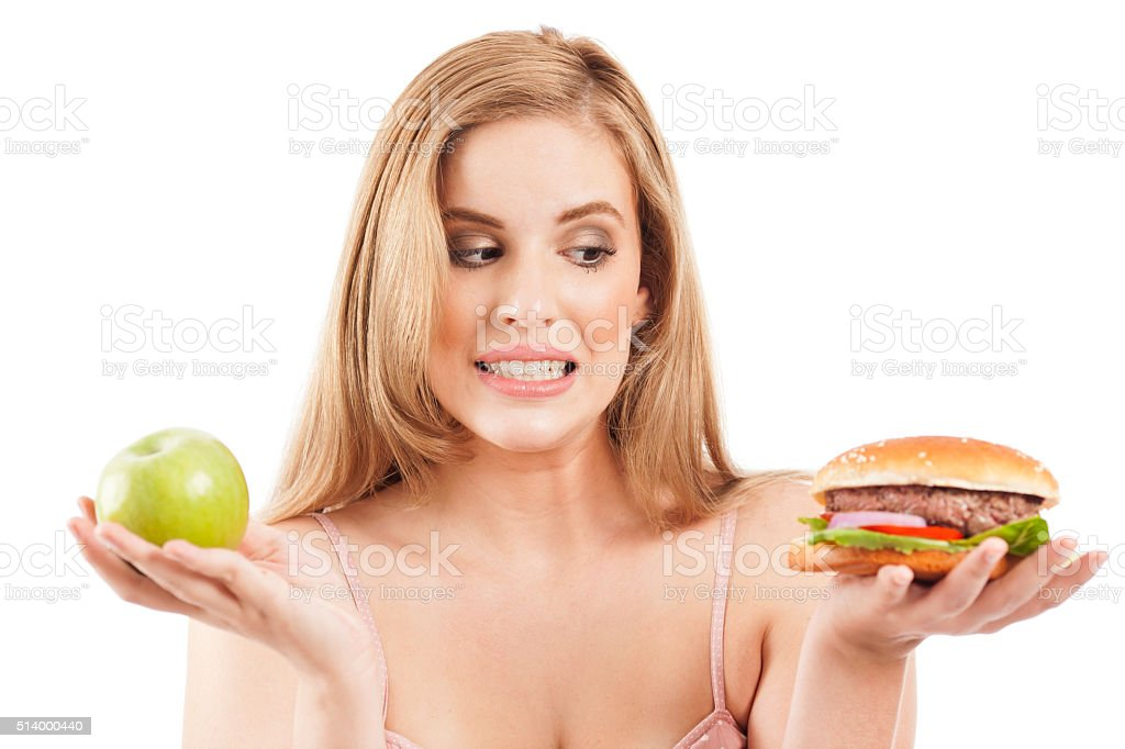 Making choice between unhealthy and healthy food. stock photo