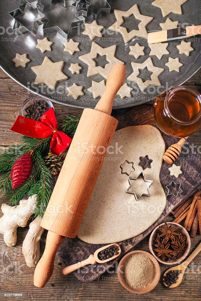Making Christmas Cookies with traditional gingerbread cookies ingredients stock photo