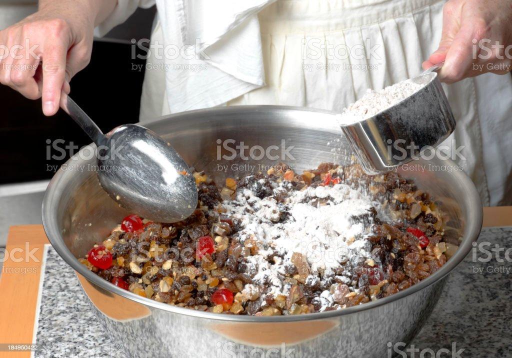Making Christmas Fruit Cake. stock photo