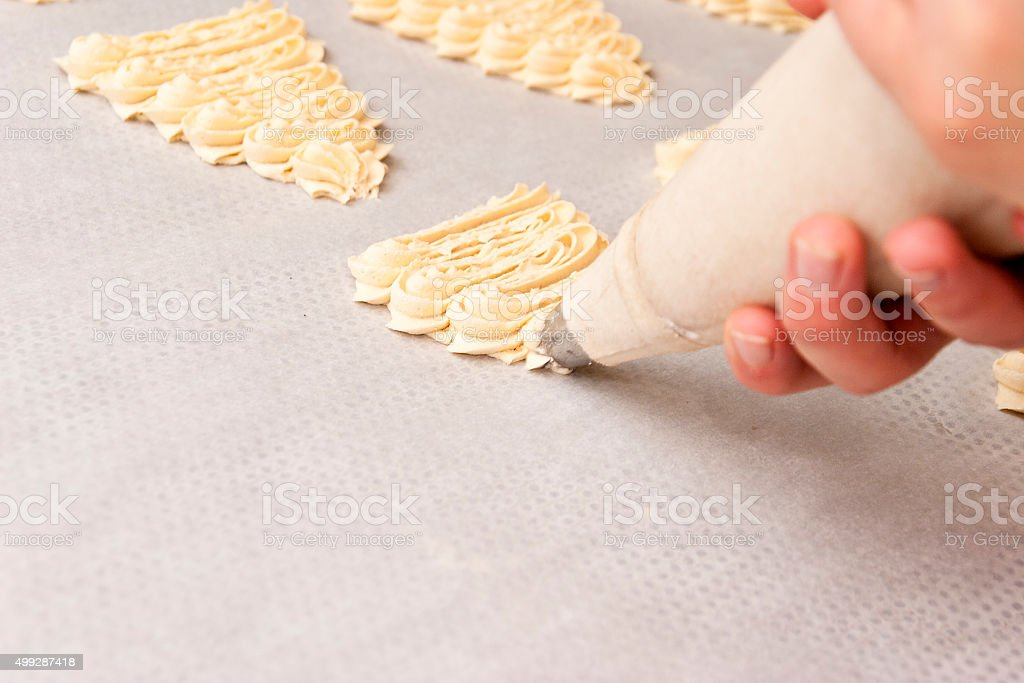 Making Christmas Tree Cookies stock photo