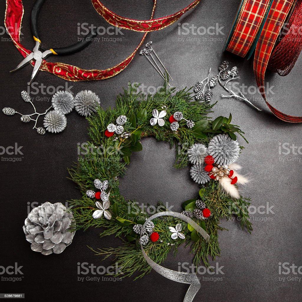 making Christmas wreath stock photo