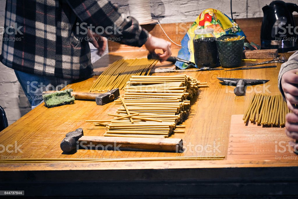 making church candles by hand stock photo