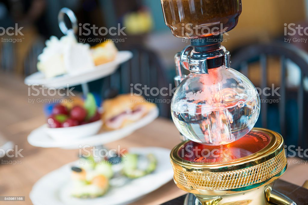 making coffee with syphon coffee machine stock photo