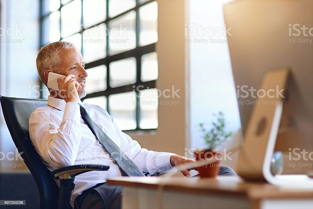 Making connections to expand his client base stock photo