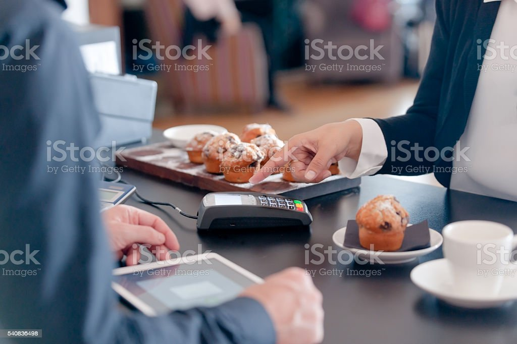 Making contactless payment in cafe stock photo