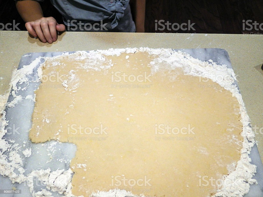 making cookies with kid stock photo