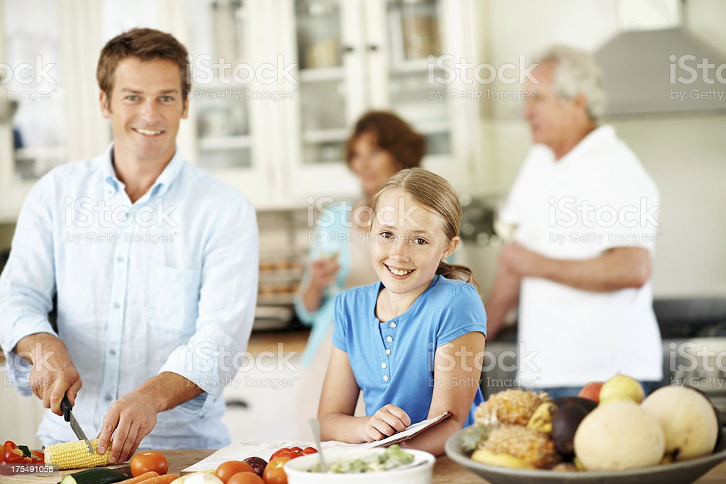 Making cooking a team effort royalty-free stock photo