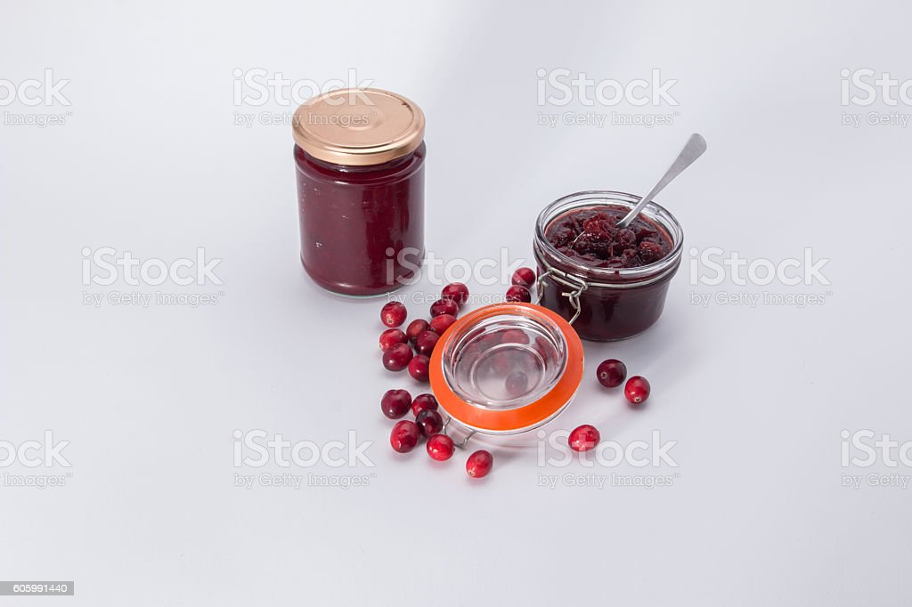 Making cranberry relish/sauce filled jars stock photo