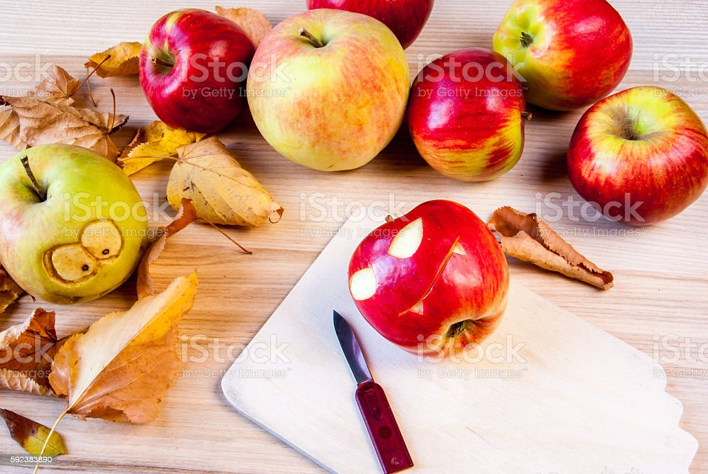 Making creepy and funny monsters of apples stock photo