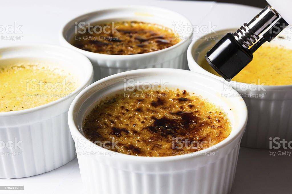 Making Crème Brulée royalty-free stock photo