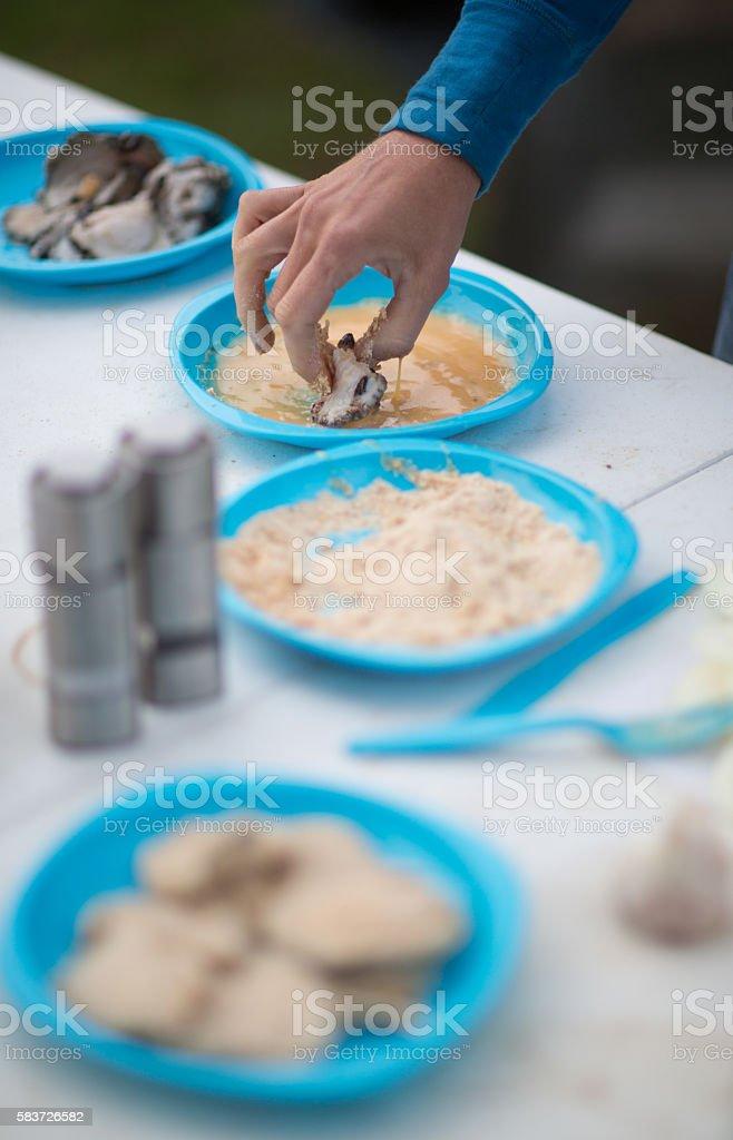 Making Crumbed Abalone stock photo