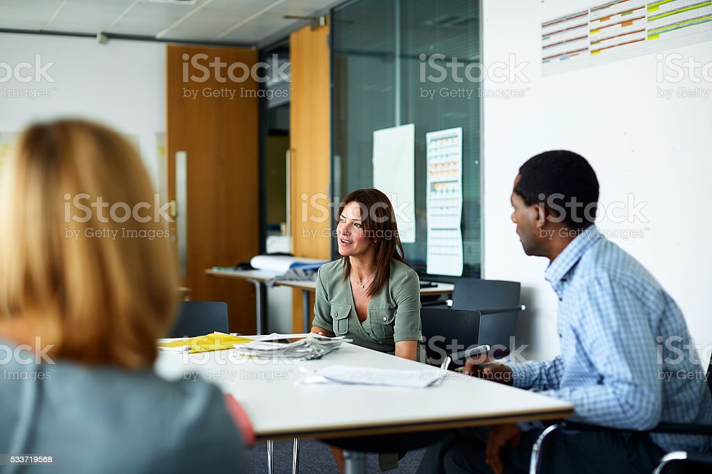 Making decisions in the boardroom stock photo