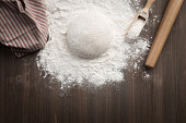 Making dough over wooden table
