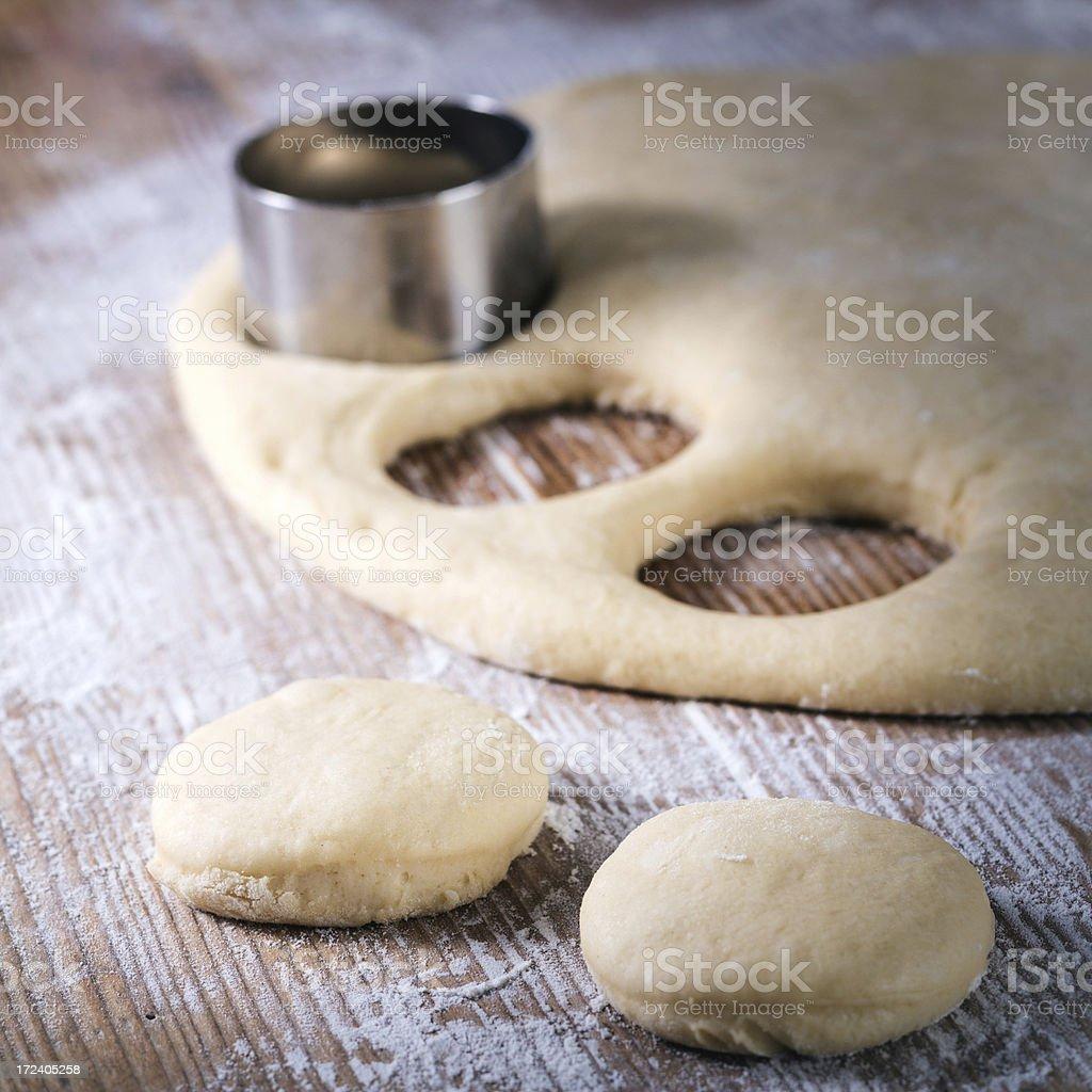 Making doughnuts stock photo