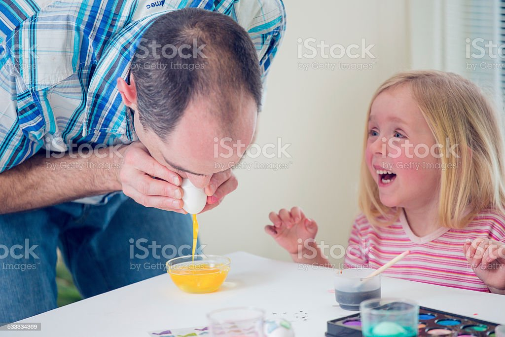 Making Easter Eggs with Daddy stock photo