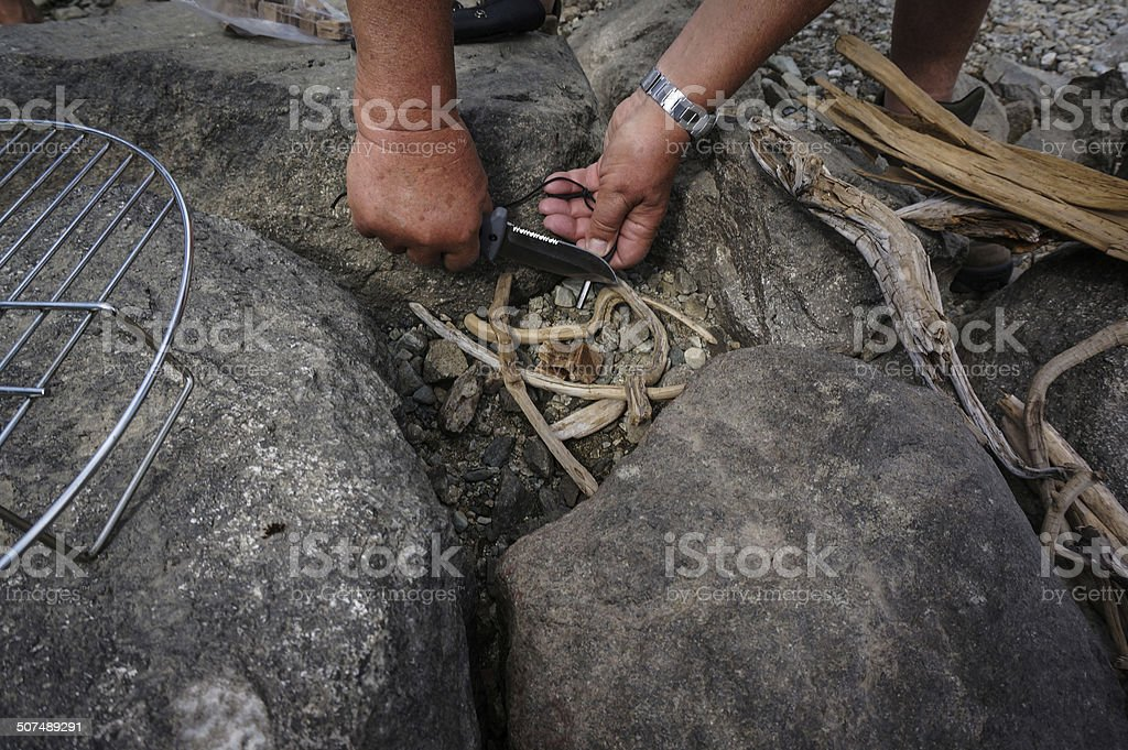 Making fire with flint royalty-free stock photo