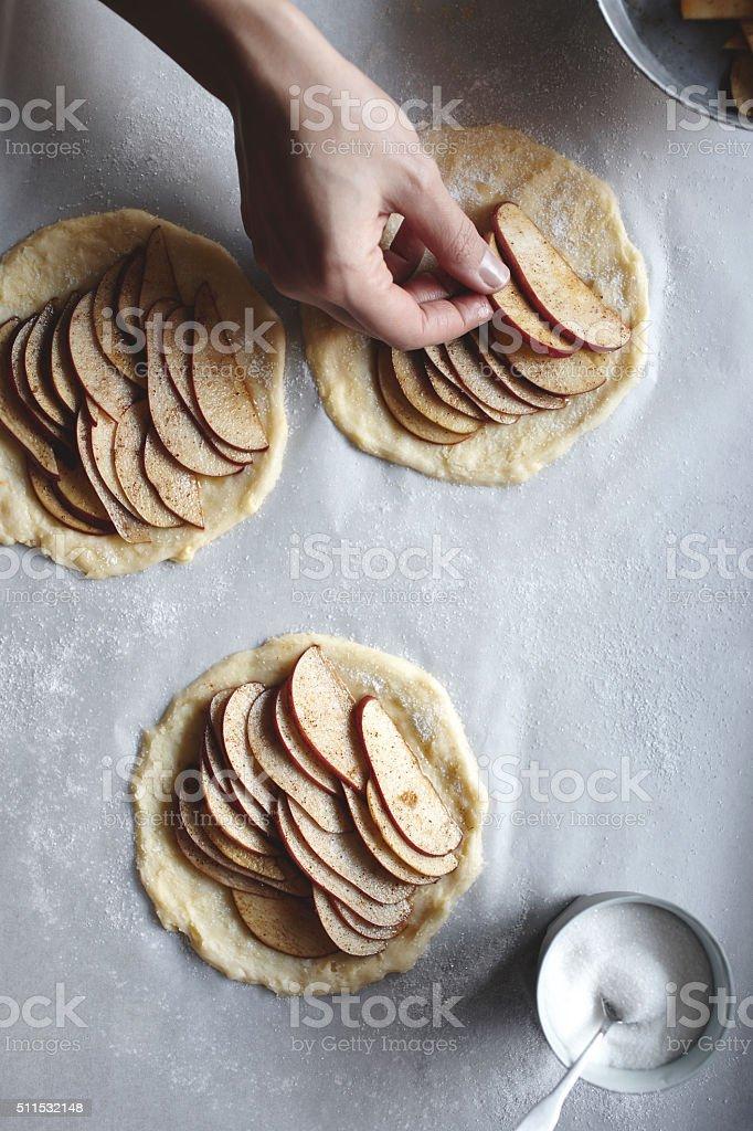 Making french style apple tarts stock photo
