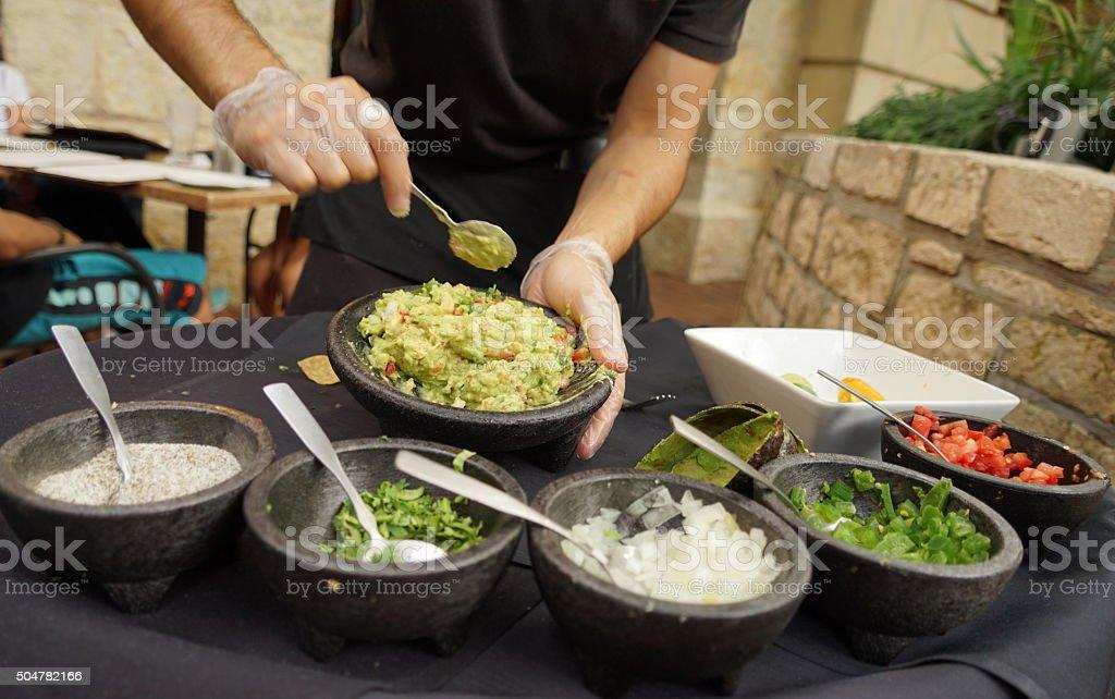 Making fresh guacamole stock photo