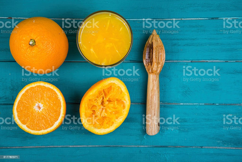 Making fresh organic oranges squeezed juice on table stock photo