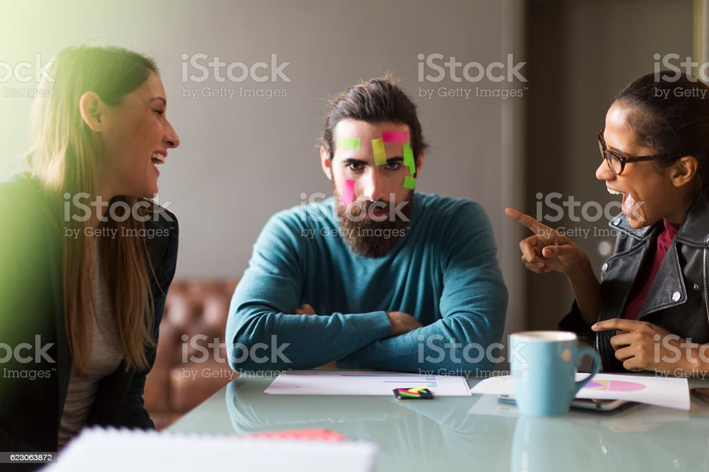 Making fun of office partner. stock photo