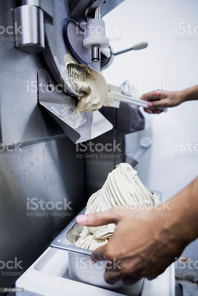 making gelato ice cream with modern machine stock photo