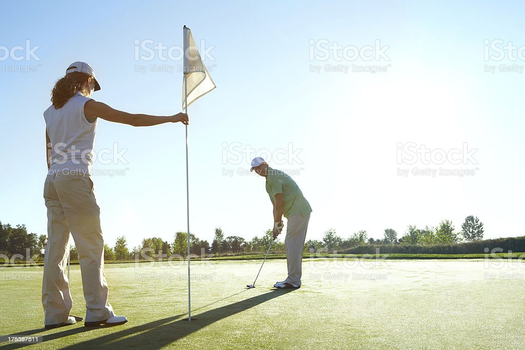 Making golfing a team sport stock photo