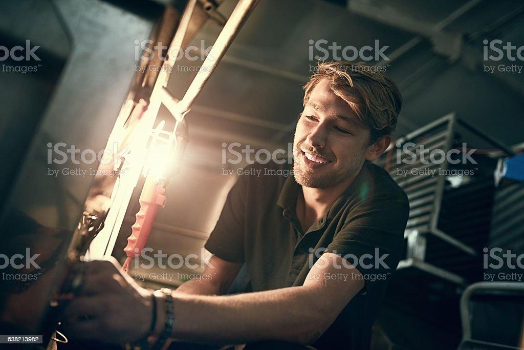 Making good progress on his repairs stock photo