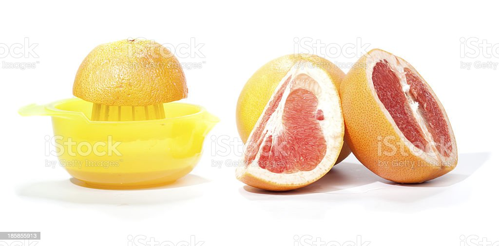 Making grapefruit juice, isolated on white royalty-free stock photo