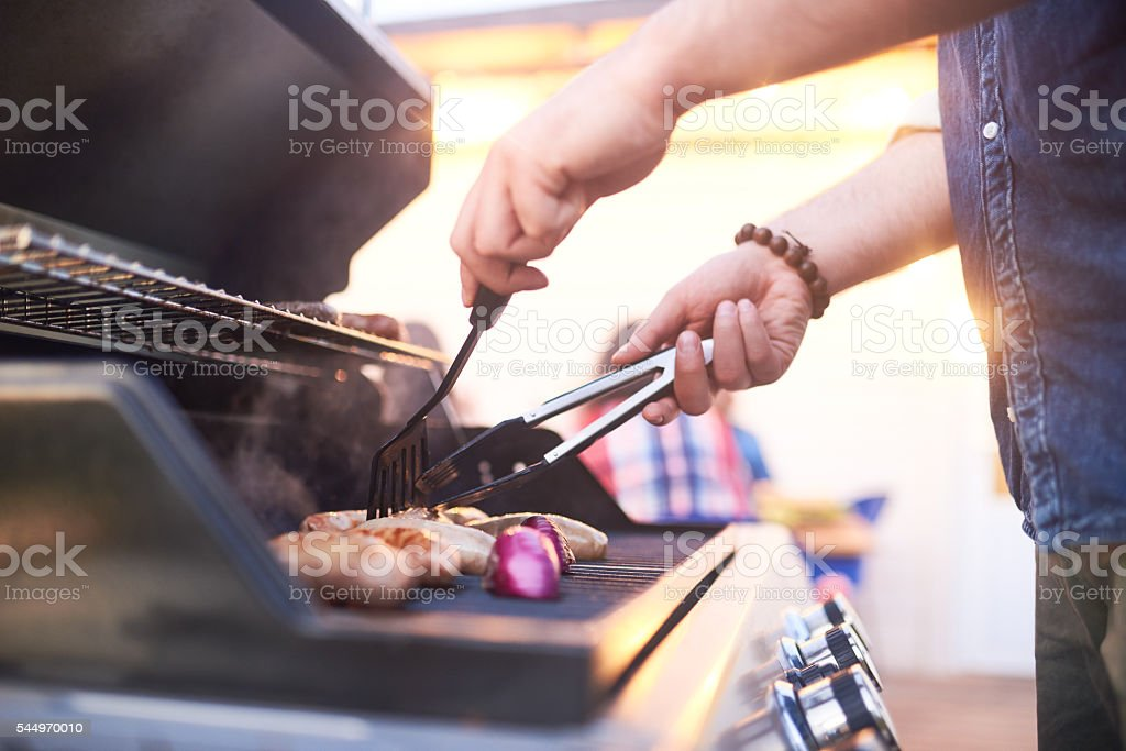 Making grilled meat stock photo