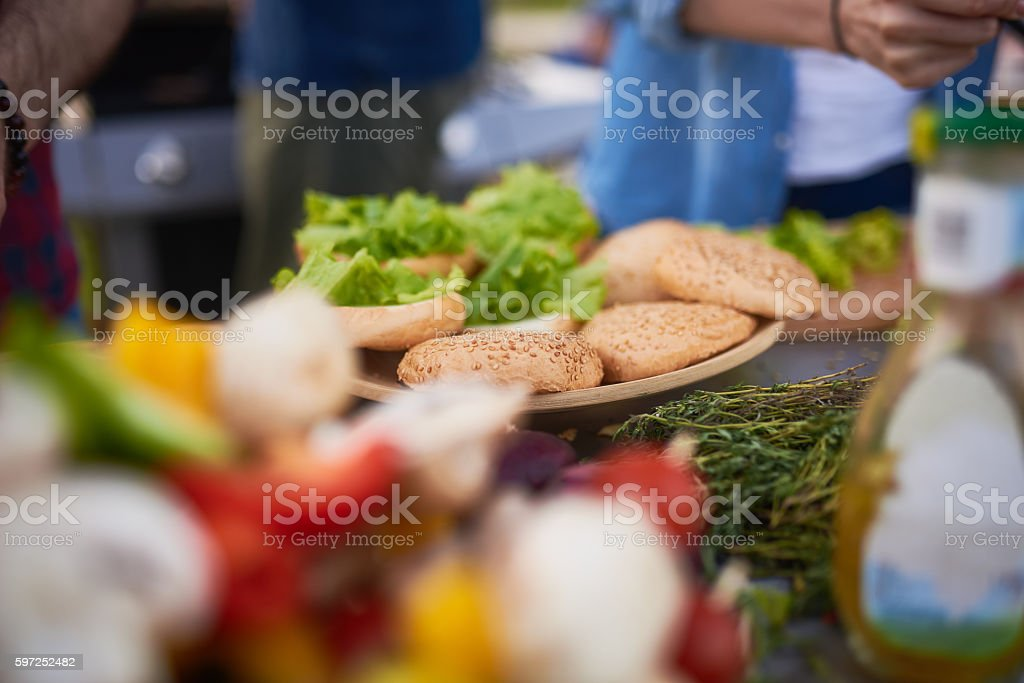 Making Hamburgers at Barbecue Party stock photo