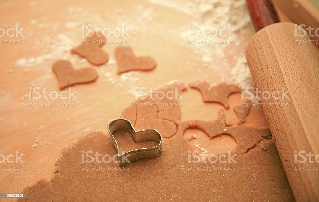 Making heart cookies stock photo