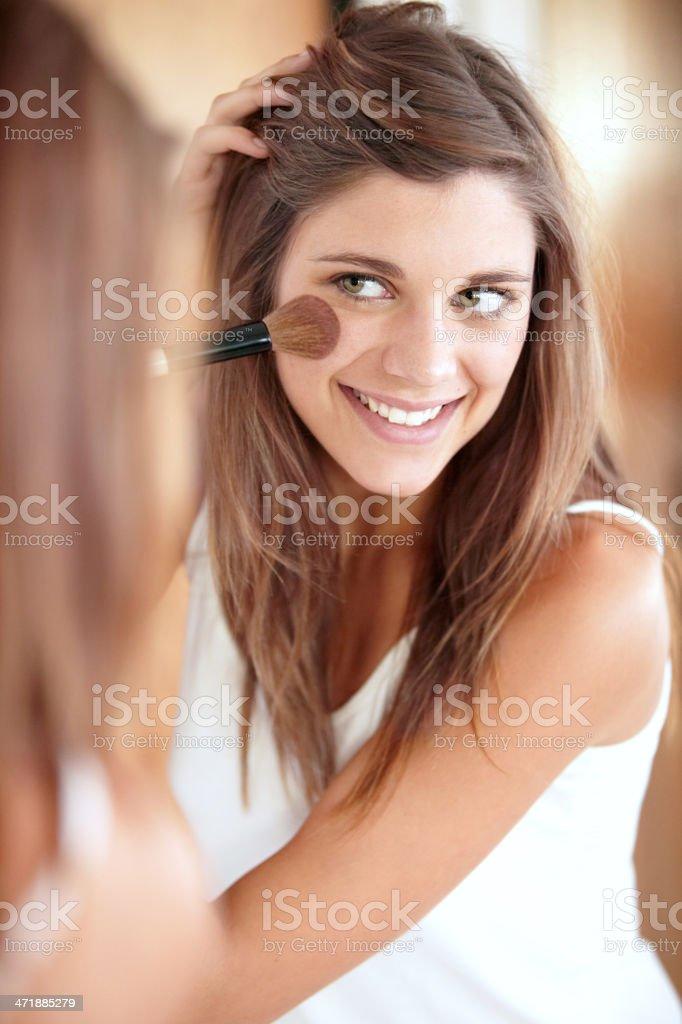 Making her cheeks rosy stock photo