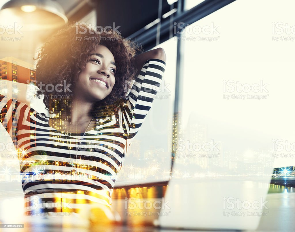 Making her dreams happen in the city stock photo