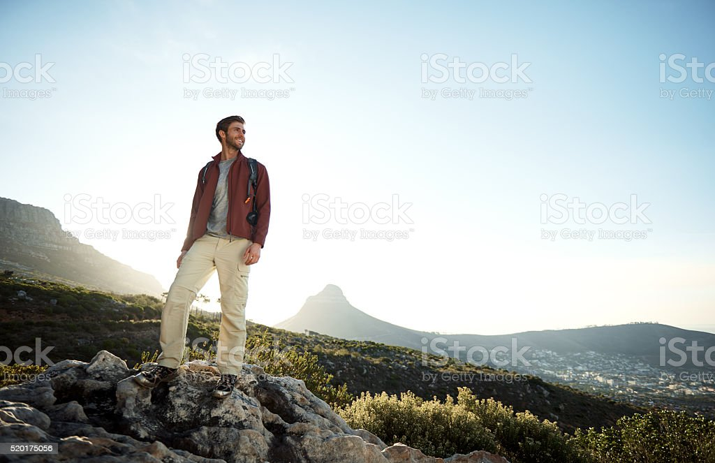 Making his way over difficult terrain stock photo