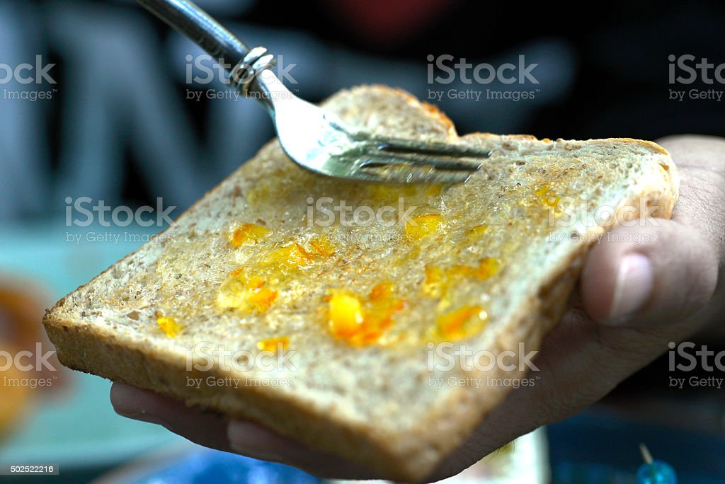 Making jam on toast or bread wheat royalty-free stock photo