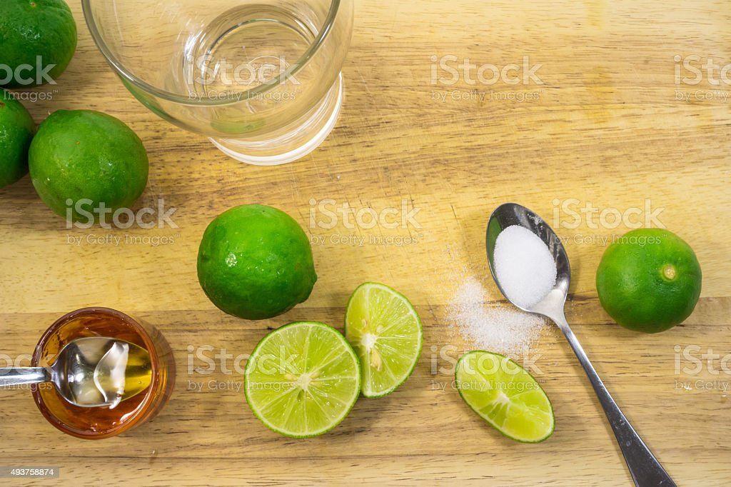 Making lime and honey herbal drink stock photo